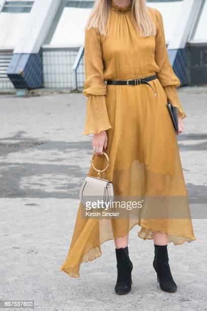 Fashion director at NetAPorter Lisa Aiken wears a Beaufille dress Chloe bag and Alaïa boots day 3 of Paris Womens Fashion Week Spring/Summer 2018 on...