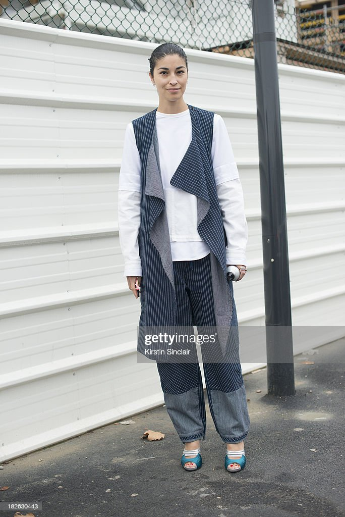 Fashion director at Tank magazine <a gi-track='captionPersonalityLinkClicked' href=/galleries/search?phrase=Caroline+Issa&family=editorial&specificpeople=2254046 ng-click='$event.stopPropagation()'>Caroline Issa</a> wearing Chloe with Prada shoes on day 6 of Paris Fashion Week Spring/Summer 2014, Paris September 29, 2013 in Paris, France.