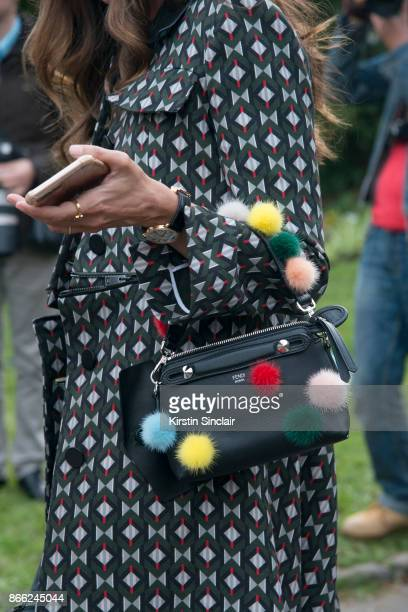 Fashion director Christina Pitanguy wears a Fendi jacket and bag day 2 of Paris Womens Fashion Week Spring/Summer 2018 on September 27 2017 in London...