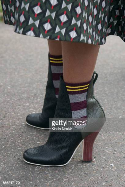 Fashion director Christina Pitanguy wears a Fendi jacket and boots day 2 of Paris Womens Fashion Week Spring/Summer 2018 on September 27 2017 in...