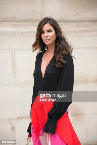 Fashion director Christina Pitanguy wears a Lenny Niemeyer dress day 2 of Paris Womens Fashion Week Spring/Summer 2018 on September 27 2017 in London...