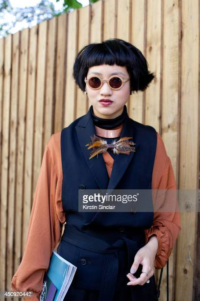 Fashion Director for Numero Thailand Fame Boonyasit wears a Lanvin waistcoat and trousers Burberry top Waiting for the Sun sunglasses vintage feather...
