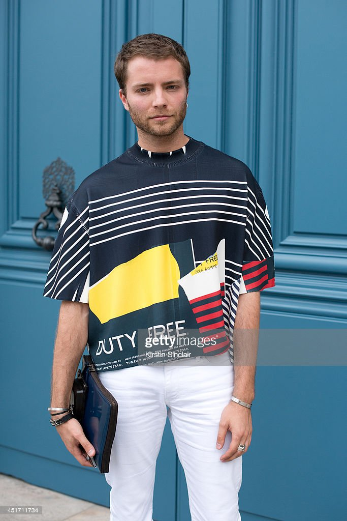 Fashion director for Ports Russia Elissey wearing Neil Barrett jeans, Lanvin bag, Tigran Avetisyan top on day 3 of Paris Collections: Men on JUNE 27, 2014 in Paris, France.