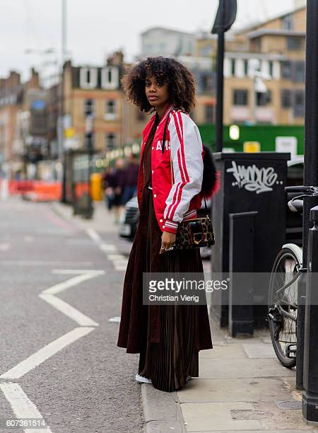 Fashion Director Instyle Germany JanMichael Quammie wearing a red white college jacket outside of of the House of Holland during London Fashion Week...