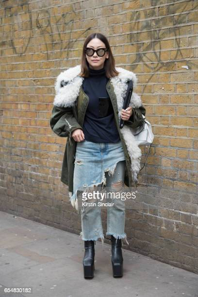Fashion director Maiko Shibaja wears a Balenciaga parka jacket and shoes R13 jeans Loewe bag and Soya sunglasses on day 5 of London Womens Fashion...