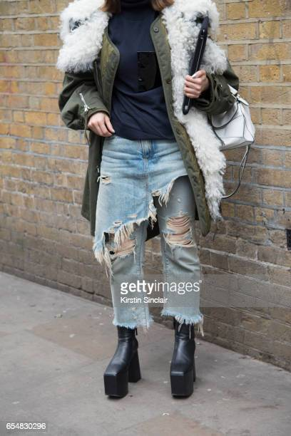 Fashion director Maiko Shibaja wears a Balenciaga parka jacket and shoes R13 jeans Loewe bag on day 5 of London Womens Fashion Week Autumn/Winter...