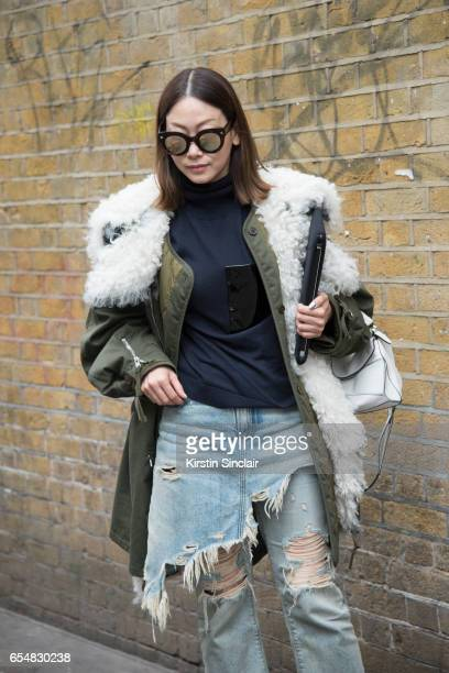 Fashion director Maiko Shibaja wears a Balenciaga parka jacket R13 jeans Loewe bag and Soya sunglasses on day 5 of London Womens Fashion Week...