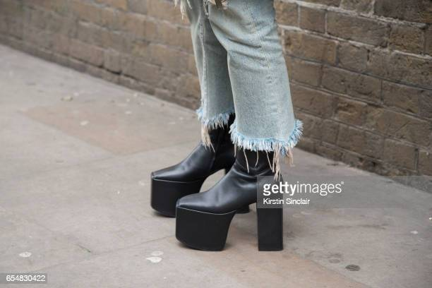 Fashion director Maiko Shibaja wears a Balenciaga shoes R13 jeans on day 5 of London Womens Fashion Week Autumn/Winter 2017 on February 21 2017 in...