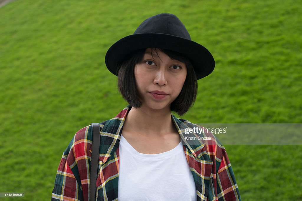 Fashion Ediotor for mens Elle Magazine China Yoyo Lu wears a YSL hat, Yohji Yamamnoto jacket, Cos T shirt on day 3 of Paris Collections: Men on June 28, 2013 in Paris, France.