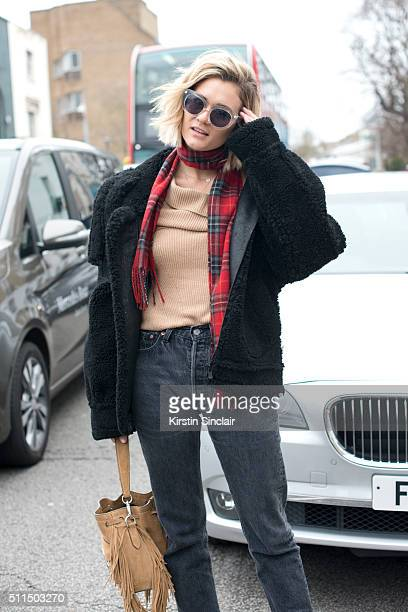 Fashion editor and blogger Adenorah wears Levi's jeans River Island top scarf and bag Zoe Jordan jacket and vintage sunglasses on day 2 during London...