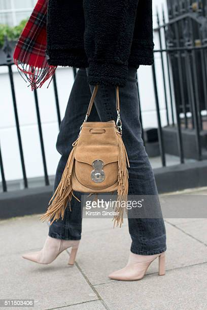 Fashion editor and blogger Adenorah wears Levi's jeans River Island scarf and bag Zoe Jordan jacket and Stella Luna boots on day 2 during London...