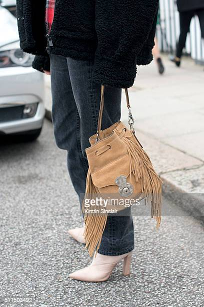 Fashion editor and blogger Adenorah wears Levi's jeans River Island bag Zoe Jordan jacket and Stella Luna boots on day 2 during London Fashion Week...