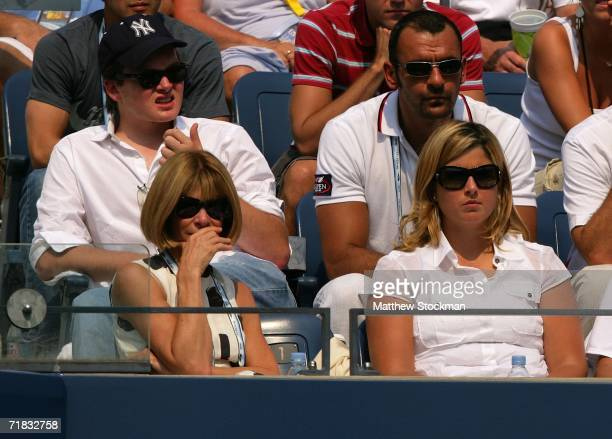 Fashion Editor Anna Wintour and Mirka Vavrinec watche as Roger Federer of Switzerland takes on Nikolay Davydenko of Russia during the men's semifinal...