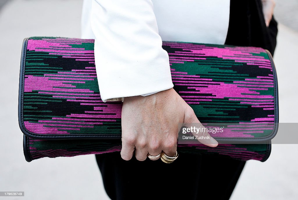 Fashion Editor at Esquire Nic Screws (clutch detail) is seen outside the Shades of Grey presentation with a Missoni bag on September 4, 2013 in New York City.