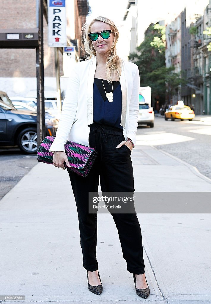 Fashion Editor at Esquire Nic Screws is seen outside the Shades of Grey presentation with a Missoni bag on September 4, 2013 in New York City.