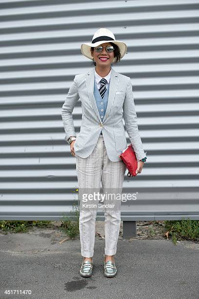 Fashion editor at Esquire Singapore Janie Cai wearing a Masiimo Dutto jacket and trousers Churches shoes Tory Burch bag vintage sunglasses Uniqlo hat...