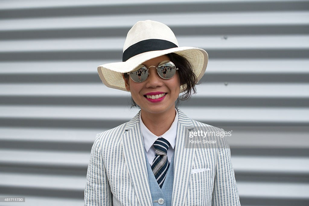 Fashion editor at Esquire Singapore Janie Cai wearing a Masiimo Dutto jacket, vintage sunglasses, Uniqlo hat and shirt and a menswear waistcoat on day 3 of Paris Collections: Men on JUNE 27, 2014 in Paris, France.