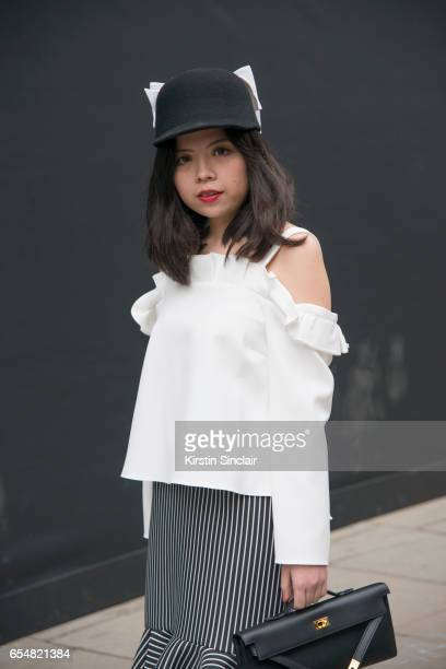 Fashion editor at FavourUp Magazine Veronica Chang wears a Top Shop top Hermes bag and hat from a Parisian boutique on day 5 of London Womens Fashion...