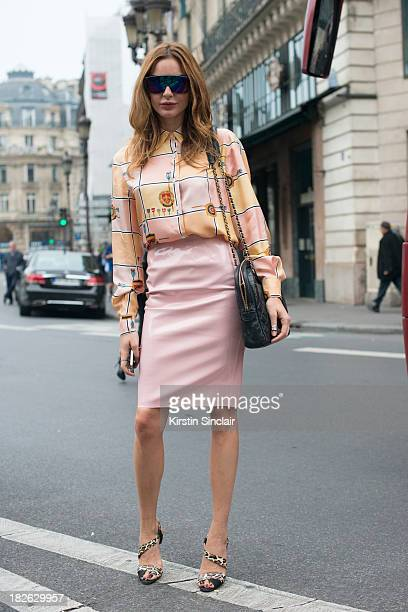 Fashion editor at large of Vogue Turkey Ece Sukan wears a vintage top a Chanel bag top Shop skirt Brian Attwood shoes and Venice Beach sunglasses on...