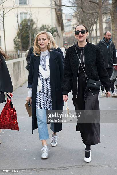 Fashion Editor at Refinery 29 Annie Georgia Greenberg with a guest on day 8 during Paris Fashion Week Autumn/Winter 2016/17 on March 8 2016 in Paris...