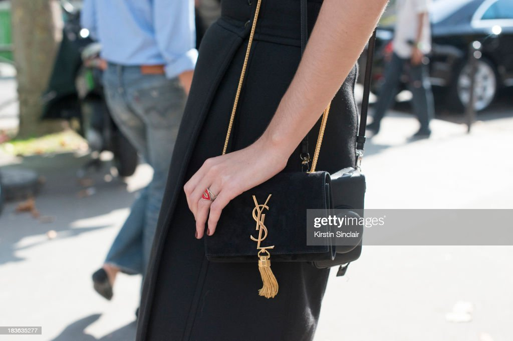 Fashion Editor at Russian Harper's Bazaar Maria Kolosova wearing a Sonia by Sonia Rykiel top and skirt and a YSL bag on day 9 of Paris Fashion Week Spring/Summer 2014, Paris October 02, 2013 in Paris, France.