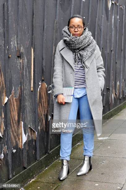 Fashion editor at The Metro Naomi Mdudu wears a BHS scarf Hobbs coat AND jeans Zara boots Christian Lacroix for Petit Bateaux top and a Modalu bag...