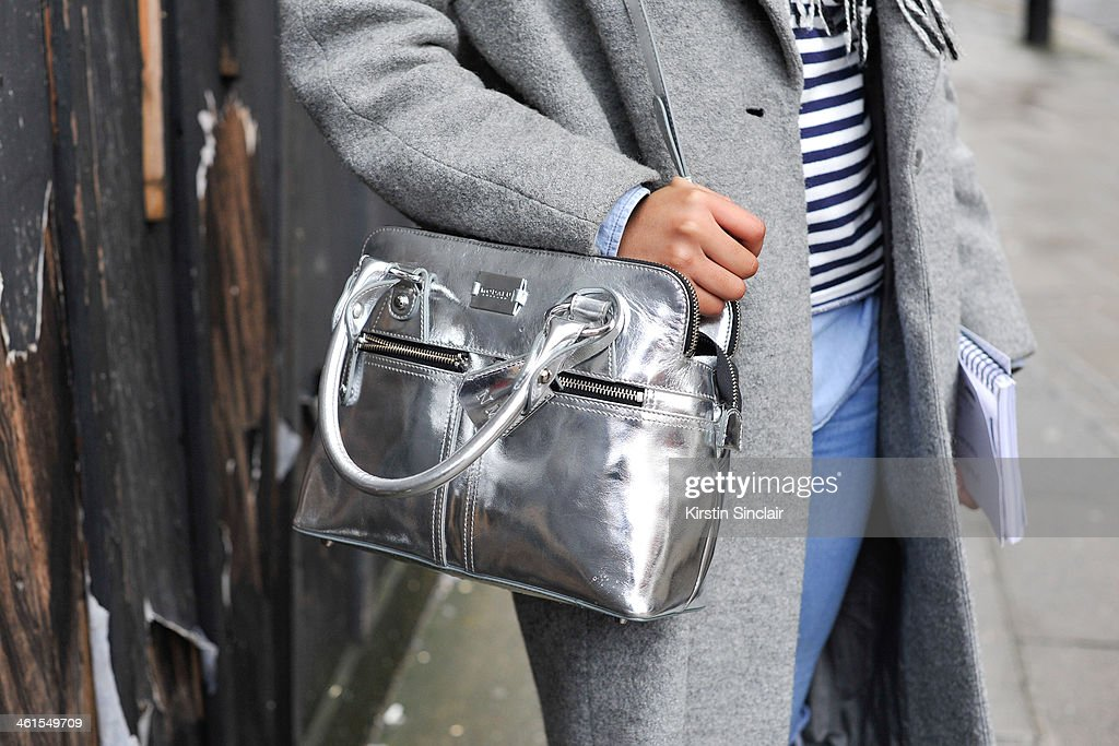 Fashion editor at The Metro Naomi Mdudu wears a BHS scarf, Hobbs coat, AND jeans, Christian Lacroix for Petit Bateaux top and a Modalu bag day 2 of London Mens Fashion Week Autumn/Winter 2014, on January 07, 2014 in London, England.