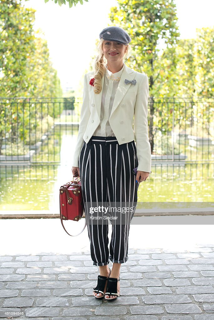 Fashion Editor at The Rake magazine Sarah Anne Murray wearing vintage trousers and bag, Borcelino hat, Santoni shoes and a Ralph Lauren jacket on day 2 of Paris Collections: Men on June 26, 2014 in Paris, France.