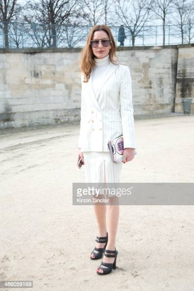 Fashion Editor Ece Sukan wears an Ipekyol suit Yasbukey bag Cazal sunglasses and Prada shoes on day 5 of Paris Collections Women on March 01 2014 in...