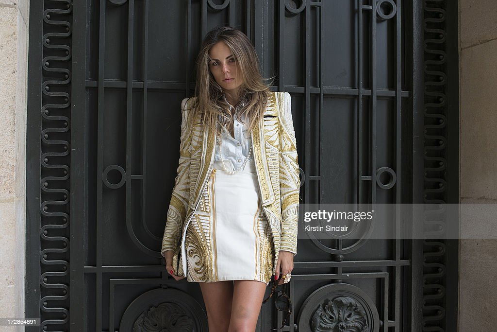Fashion Editor Erica Pelosini wears Balmain jacket and skirt, Celne sunglasses, Chanel necklace, Zara shirt, YSL ring and an Alexander McQueen clutch bag on day 2 of Paris Collections: Womens Haute Couture on July 02, 2013 in Paris, France.