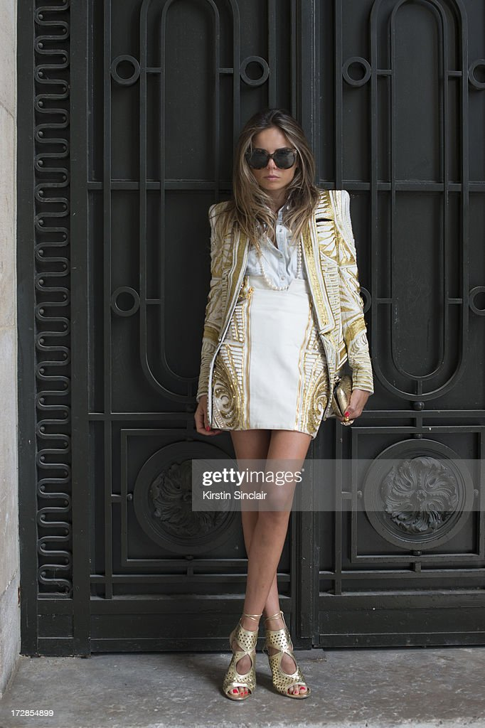Fashion Editor Erica Pelosini wears Balmain jacket and skirt, Celne sunglasses, Aquazurra shoes, Chanel necklace, Zara shirt, YSL ring and an Alexander McQueen clutch bag on day 2 of Paris Collections: Womens Haute Couture on July 02, 2013 in Paris, France.