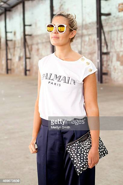 Fashion Editor for Daily Telegraph Elle Halliwell wears Karen Walker sunglasses Balmain top Givency bag and Iconic trousers at MercedesBenz Fashion...