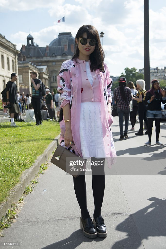 Fashion Editor for Elle China Leaf Greener wears a Christopher Kane jacket, Alaia dress, Vivita cardigan, Acne shoes, Moynat bag, The Row for Linda Farrow sunglasses on day 5 of Paris Collections: Men on June 30, 2013 in Paris, France.