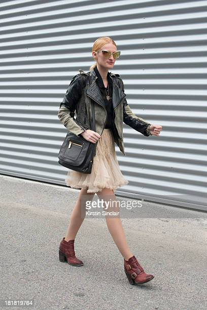 Fashion editor for Fad magazine Taylor Aube wears a vintage skirt Jeffrey Campbell boots Kooba bag C Luce jacket and Tom Ford sunglasses on day 2 of...