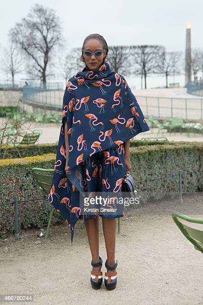 Fashion editor for Garage magazine Michelle Elie wears a Prim by Michelle Elie bag Delpozo top and skirt Miu Miu sunglasses and Rodarte shoes on day...
