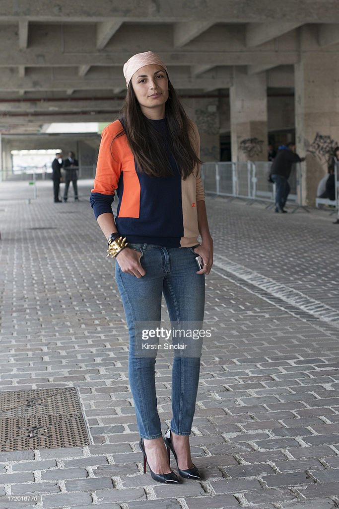 Fashion Editor for GQ France Laetitia Paul wears a Celine scarf, and sweater, and other stories jeans Collections: Men on June 28, 2013 in Paris, France.