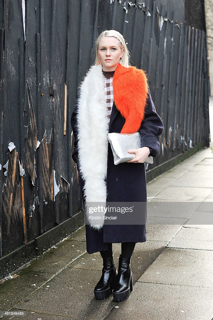 Fashion editor for GQ style Victoria Higgs wears a vintage coat, Stella McCartney boots, Saint Laurent bag, Prada scarf and a Christopher Kane top day 2 of London Mens Fashion Week Autumn/Winter 2014, on January 07, 2014 in London, England.