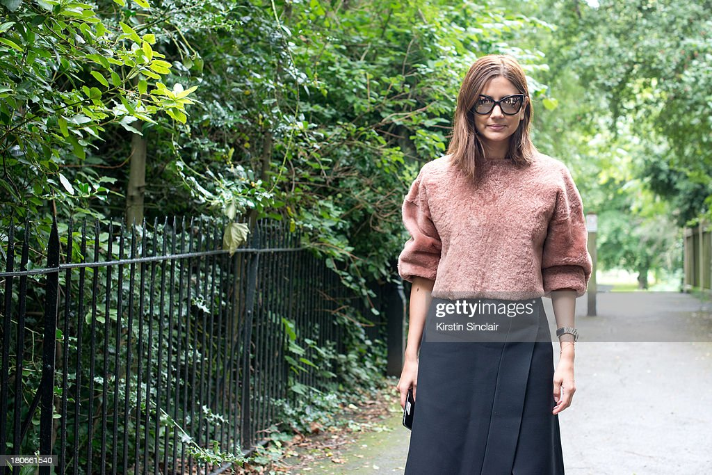 Fashion editor for Harpers Bazaar Christina Centenera wears a Prada skirt Top Shop top and Chanel sunglasses on day 3 of London Fashion Week Spring/Summer 2013, on September 15, 2013 in London, England.