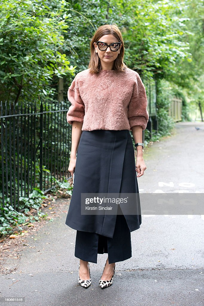 Fashion editor for Harpers Bazaar Christina Centenera wears Celine shoes, Prada skirt Top Shop top and Chanel sunglasses on day 3 of London Fashion Week Spring/Summer 2013, on September 15, 2013 in London, England.