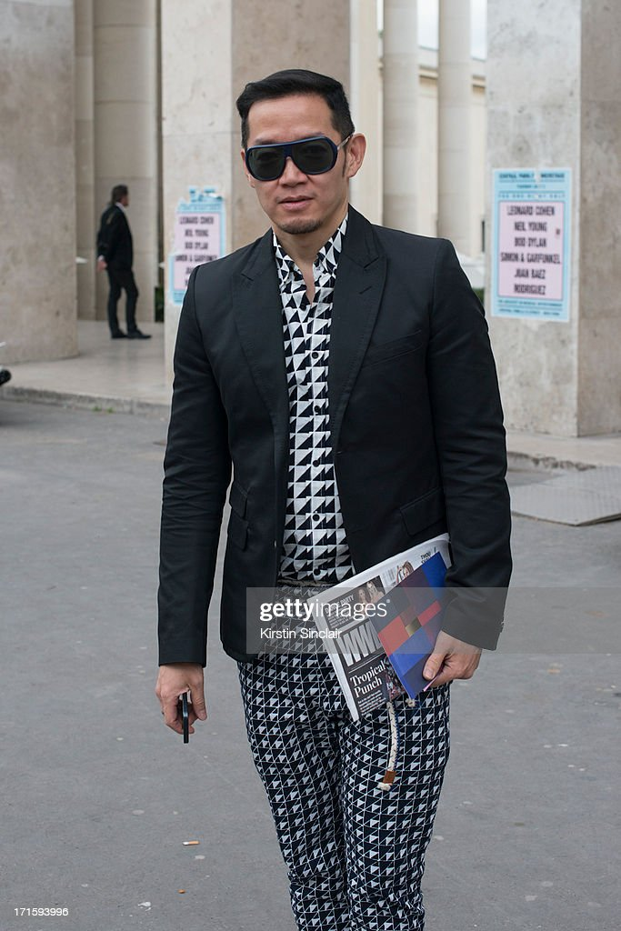 Fashion Editor for Harpers Bazaar Indonesia Joe Lim wears Raf Simons sunglasses, Neil Barrett jacket, Undercover shoes and a Populo shirt and trousers sighting on day 1 of Paris Collections: Men on June 26, 2013 in Paris, France.