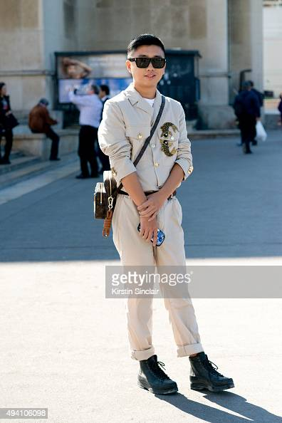 Fashion Editor for Hong Kong Tatler Declan Chen wears a Chloe dress and bag Rayban sunglasses and Isabel Marant shoes on day 3 during Paris Fashion...