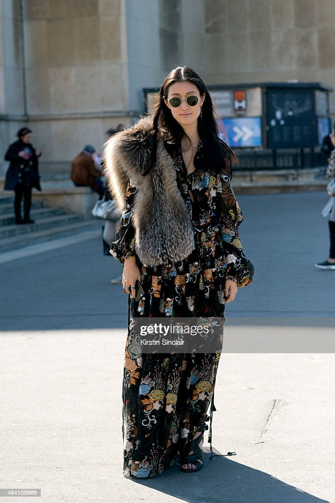 Fashion Editor for Hong Kong Tatler Justine Lee wears a Chloe dress and bag Rayban sunglasses and Isabel Marant shoes on day 3 during Paris Fashion...