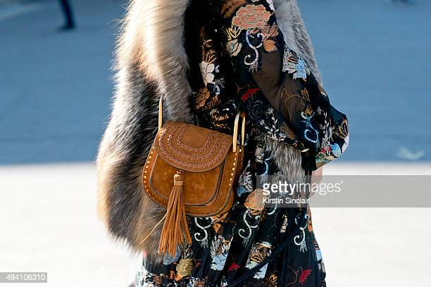 Fashion Editor for Hong Kong Tatler Justine Lee wears a Chloe dress and bag on day 3 during Paris Fashion Week Spring/Summer 2016/17 on October 1...