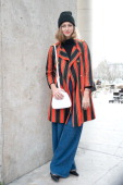 Fashion Editor for Refinery 29 Annie Georgia Greenberg wears a Balenciaga hat Uniqlo jumper Vintage coat Levi's jeans Dior bag and Prada shoes on day...