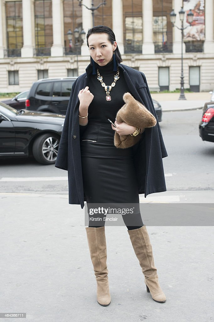 Fashion editor for Sina.com Yumeng Cheung wears vintage jewellery, Defuse boots, Zara skirt, Burberry sweater, jacket from a Korean boutique and the bag is from China day 2 of Paris Haute Couture Fashion Week Spring/Summer 2014, on January 21, 2014 in Paris, France.
