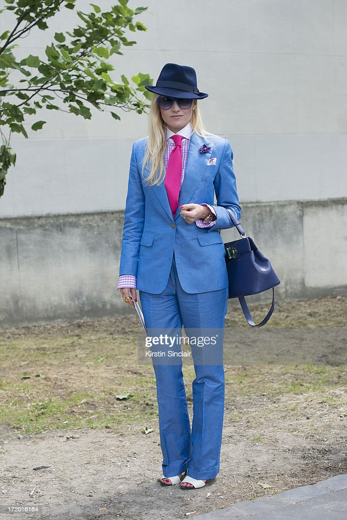 Fashion Editor for the Rake Sarah Ann Murray wears Italia Independent sunglasses, a Bespoke Q menswear suit and shirt, Bates hat, Zara shoes, Marinella tie, Dior pocket square and a bvlgari bag on day 4 of Paris Collections: Men on June 29, 2013 in Paris, France.