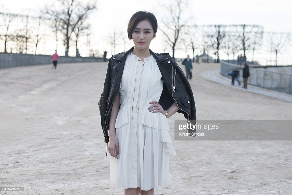 Fashion Editor for Vogue China Chi Lang wears Nina Riccion day 3 of Paris Collections: Women on February 27, 2014 in Paris, France.