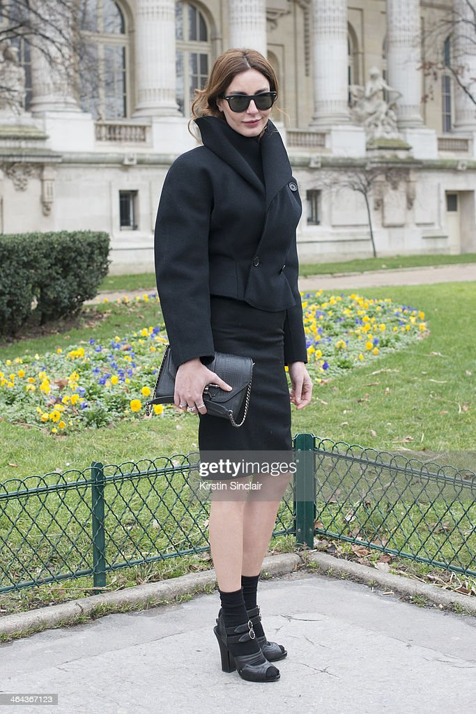 Fashion editor for Vogue Turkey, Ece Sukan wears vintage Alaia jacket and skirt, Prada shoes, Ray Ban sunglasses and a Givenchy bag day 2 of Paris Haute Couture Fashion Week Spring/Summer 2014, on January 21, 2014 in Paris, France.