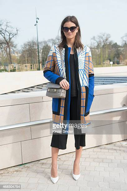 Fashion Editor Liesbeth Rasker wears a Peter Pilotto coat H and M Culottes and sunglasses LK Bennett shoes and Proenza Schouler bag on day 9 of Paris...