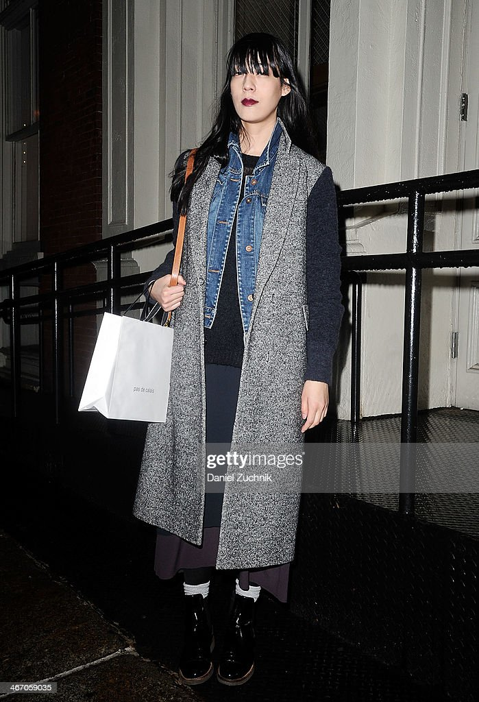 Fashion editor Nivare is seen outside the Pas de Calais show wearing a Philip Lim coat, vintage top and pants and Marni shoes on February 5, 2014 in New York City.